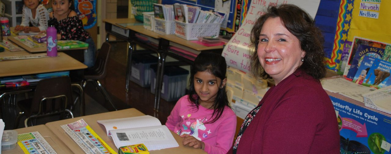 Teacher in her classroom with a student at WES