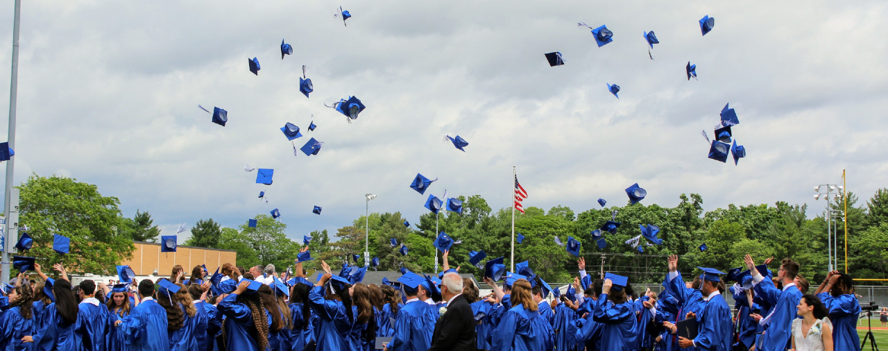 Graduation 2021- Caps being tossed in the air