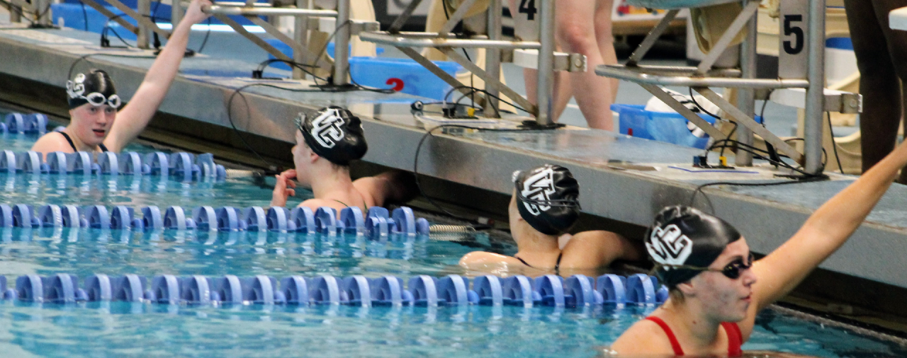 Girls Swim Meet- 4 Athletes waiting for results of race