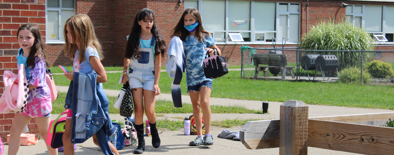 Students walking on the sidewalk at MES